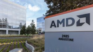 AMD (AMD) sign outside of office building with greenery