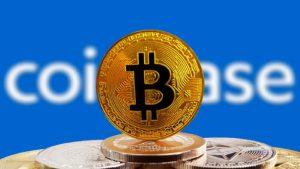 A stack of bitcoin tokens ahead of the Coinbase logo.